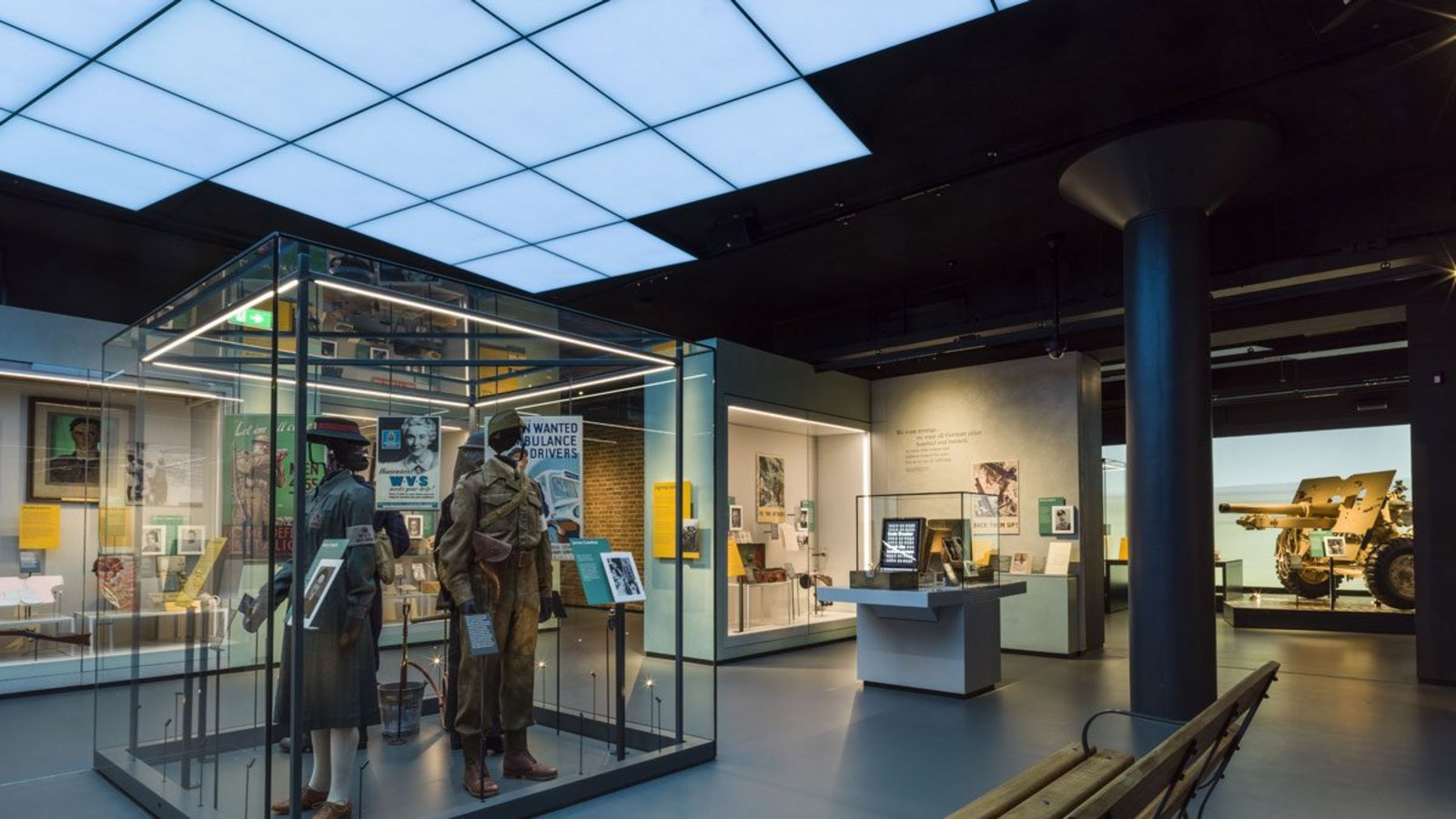 Overhead footage of the Battle of Britain and the Blitz, interspersed with calm skies, help set the scene in a gallery on what the war meant for Britain, part of the IWM Second World War Galleries, designed by Ralph Appelbaum Associates.