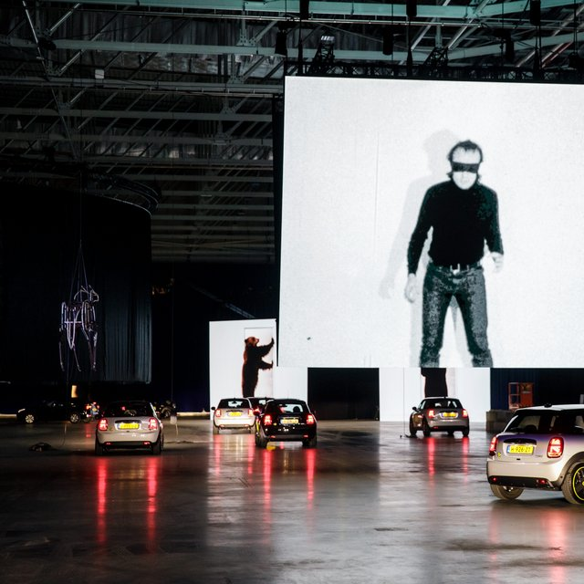 Art lovers view suspended works from coronavirus-ready electric cars in Rotterdam
