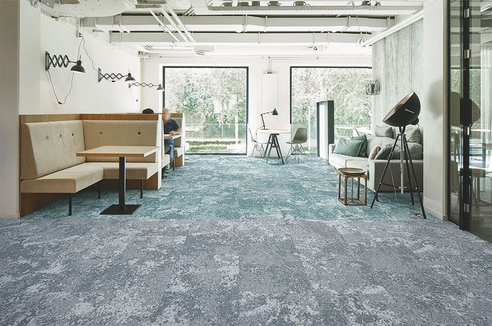 Forbo's Tessera Cloudscape carpet tiles in two shades - 3402 Ocean Winds (back) and 3401 Light Airs (front).