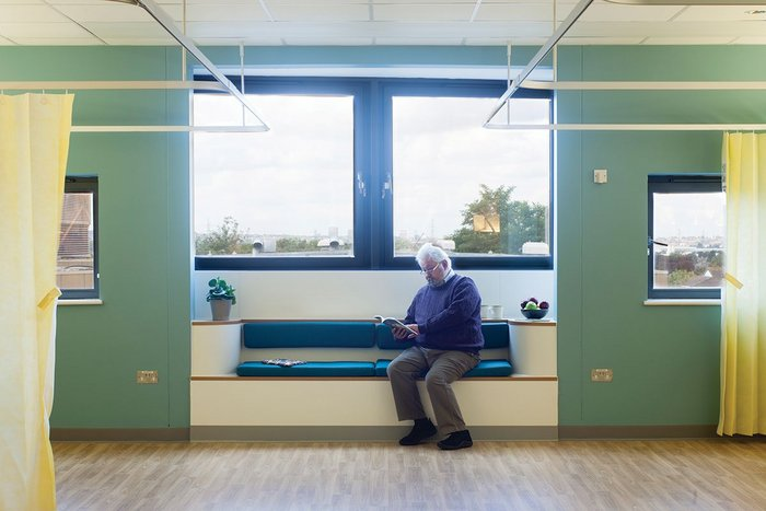 A seating bay in one of the wards at Croydon University Hospital, whose wood-effect vinyl flooring was not only matt and non-slip, but contrasted well with wall surfaces to help those with sight problems or dementia.