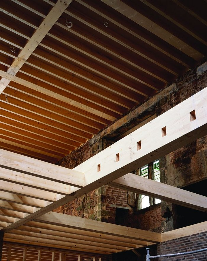 Laminated timber structural joists are crisply detailed at their interfaces and create the upper living level.