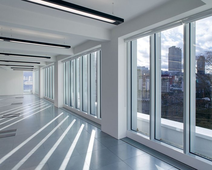 Interior of the new 4th floor. The curtain walling has external caps to create a strong vertical rhythm.