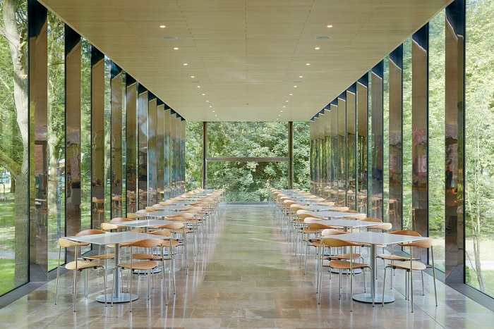 The café, which includes delicate, polished stainless steel structural mullions.