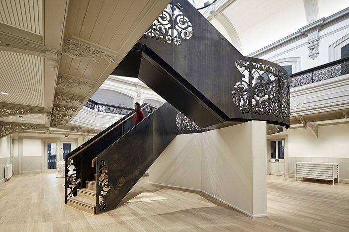 The new staircase turns the two floors of the architecture school into a world of its own.