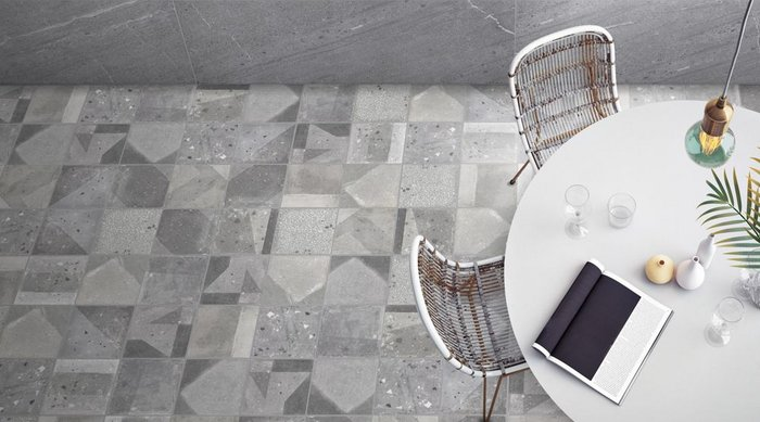 Agnes by Dune, Emporio Collection. Wall and floor porcelain tiles in 12 distinctly contemporary designs and a palette of beige and grey that can be randomly mixed. Décor tile in 20x20cm format and a variety of plain formats also available.