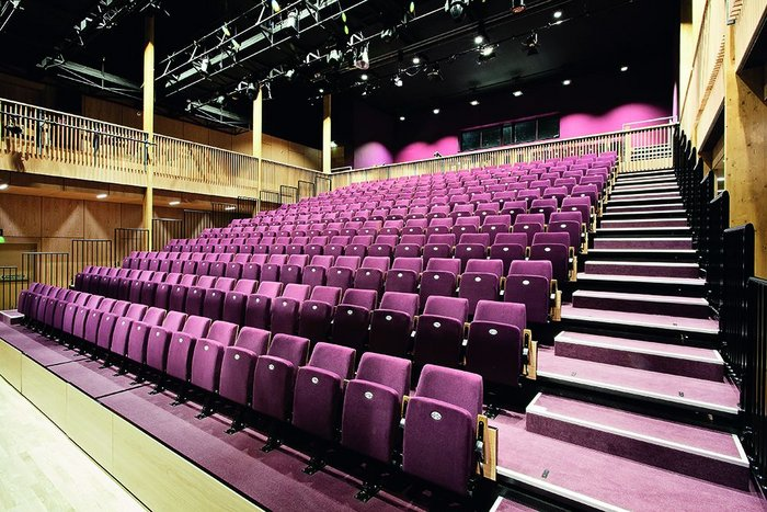 The main auditorium is a beautifully warm space lined with a gallery and panelling in oak.