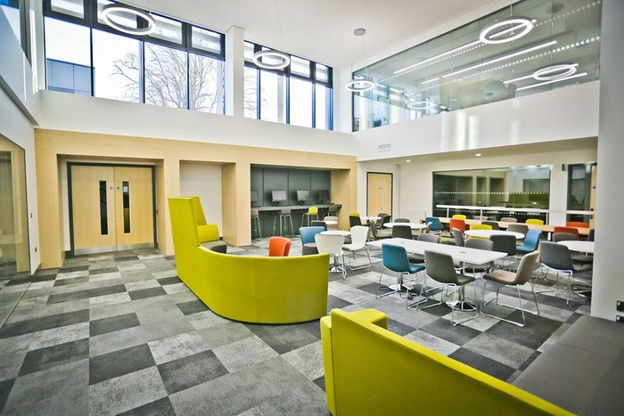 Interface Composure modular flooring in a breakout space in the Clerici building at Oxford Brookes University.