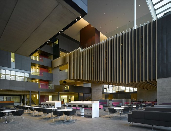 The main space is intersected by the university's various functions including the concertina-like box of a lecture theatre.
