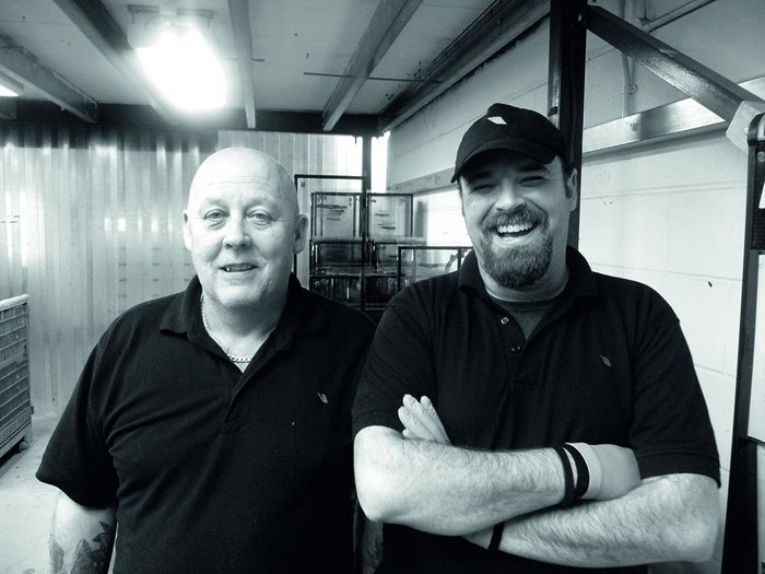 Rooflight Company employees Phil Young and Steve Lewsey make up and check the integrity of glazing  units built in the factory.