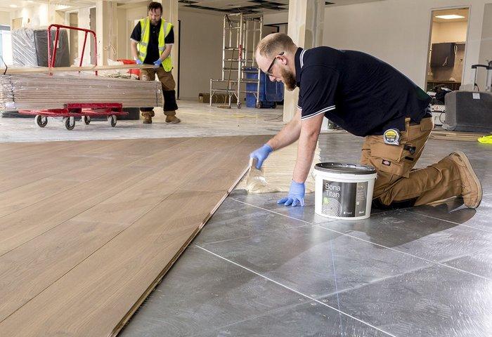 Bona Titan specified to bond wide oak boards to metal subfloor.