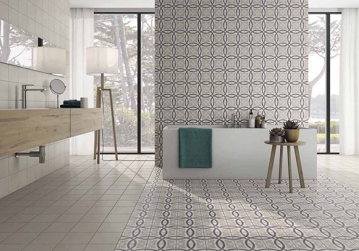 Sitges by Saloni, Pobles series. Porcelain tiles for wall and floor in a choice of five designs, including Sitges (shown), can be combined with plain tiles in Beige, Blanco, Grafito, Gris and Iris to create a custom look. Format 18.5x18.5cm.