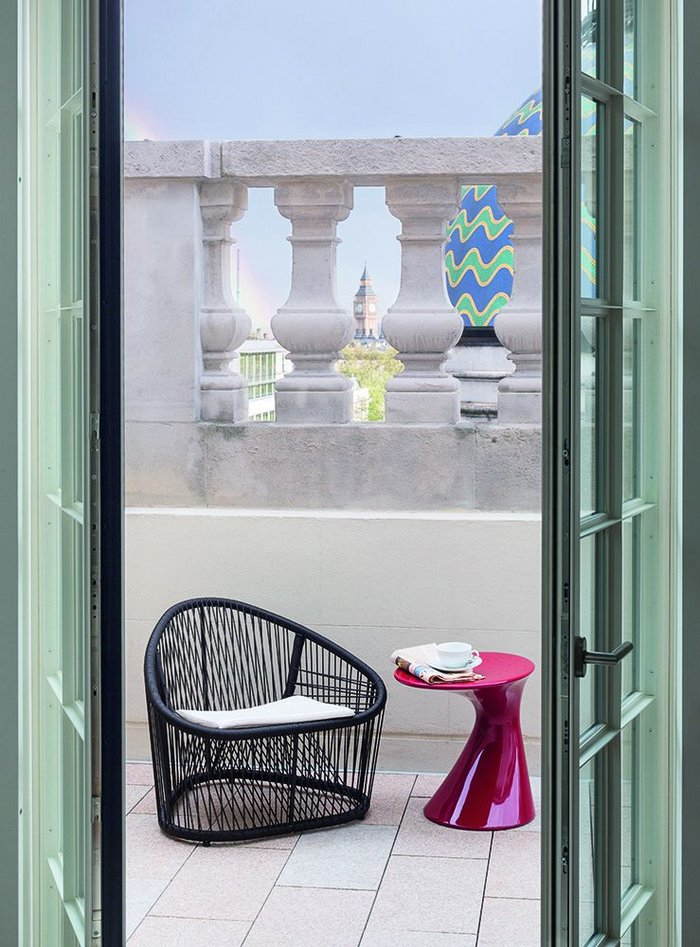 A terrace with unexpected colour and the distant icon of Big Ben on the other side of the parapet.