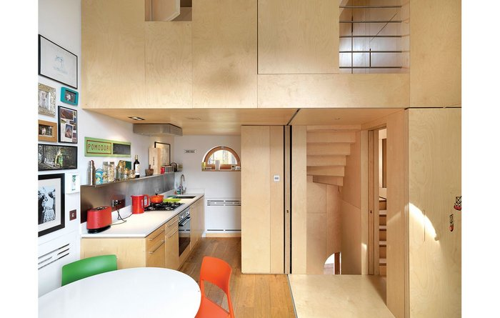 The seemingly solid walls conceal generous storage
