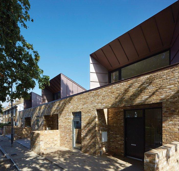 Mottled brick sitting happily alongside conservation area cottages in Walnut Tree Road.