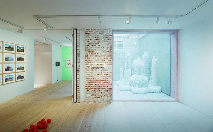 The basement gallery space looks out onto an external courtyard.