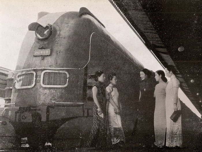 The Asia Express, the South Manchuria Railway's 'ultra-modern' high-speed train at Dalian's 'ultra-modern' railway station with 'ultra-modern Manchurian girls'.