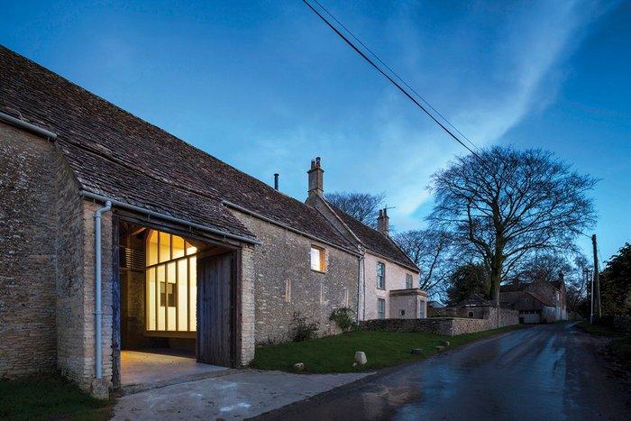 The barn and farmhouse looking east, the Pod gallery hidden inside.