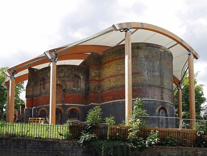 Surreal juxtaposition: Romanesque ruin meets lightweight roof.