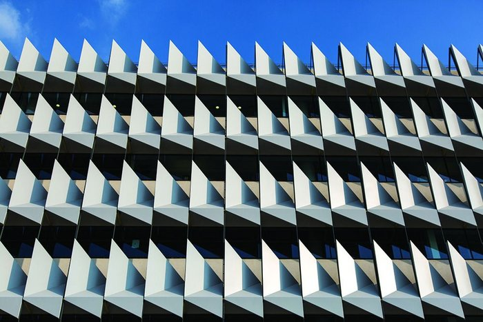 Folded steel insulation on the facade of Sheppard Robson's Masdar City HQ for Siemens