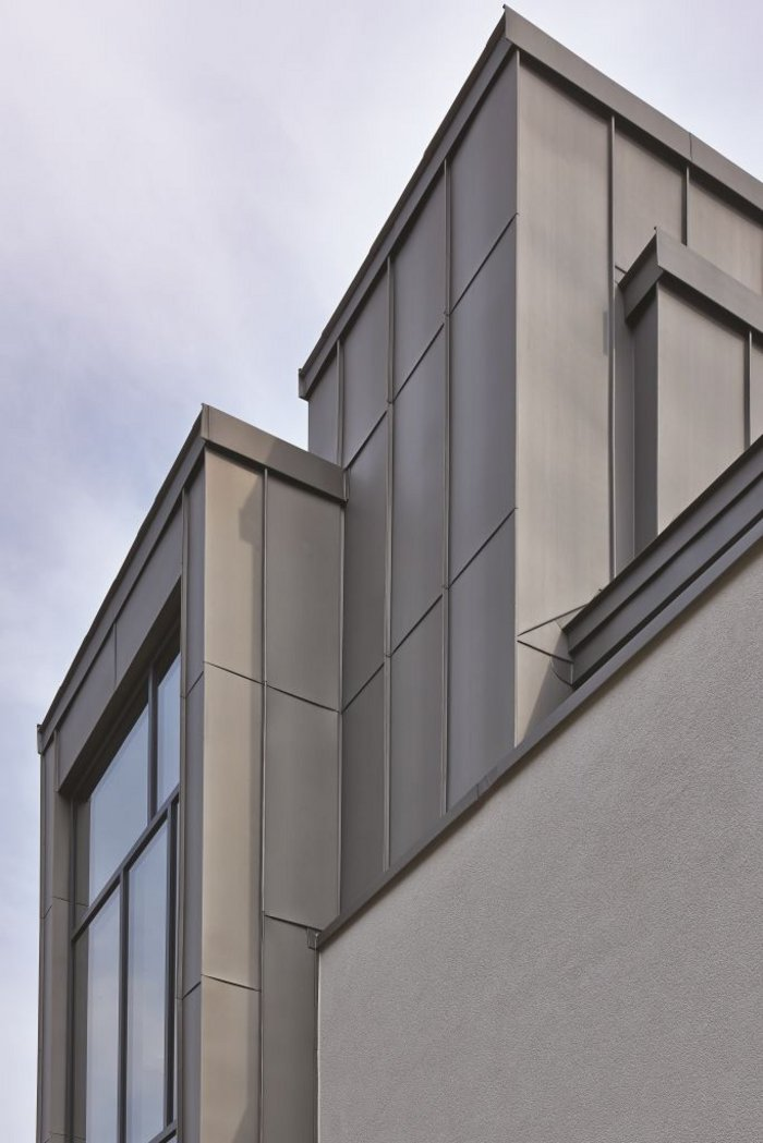 Pre-weathered zinc cladding not only gave a traditional feel, but minimised the thickness of the wall build-up
