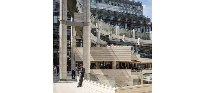 Broadgate Circus, designed as part of the wider Broadgate in the 1980s. The travertine centrepiece and spaces were reworked in 2015.