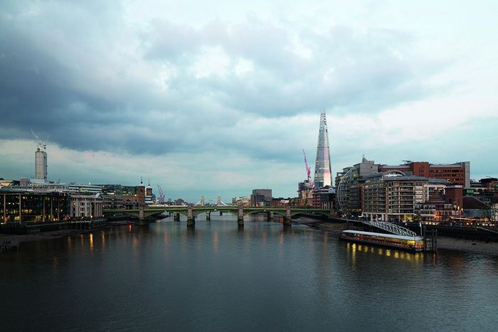 It's all about  the weather: the Shard's angled facetted flanks change with the sky. Directly opposite, the core of Rafael Viñoly's 'Walkie Talkie' tower rises.