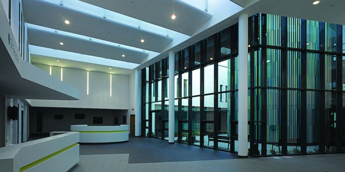 Patients are funnelled into to the central spaces which are airy and light with courtyards on either side.