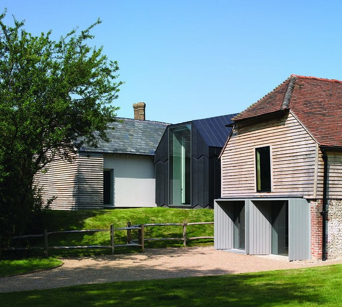 A new black zinc-clad building nestles next to the existing refurbished parts of the museum complex.