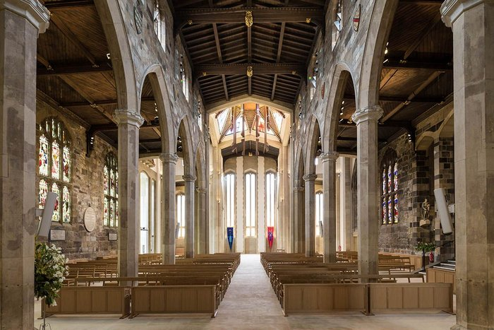 Looking back from the altar towards Bailey's western end and lantern. New floor, new moveable furniture by Thomas Ford and Partners.
