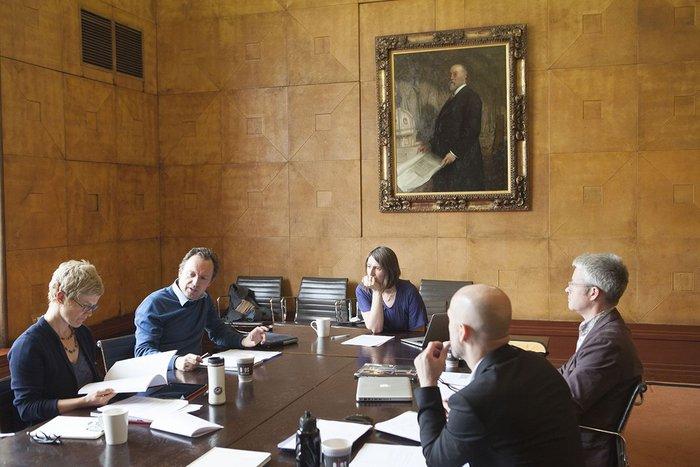 Dissertation judges discuss the entries.