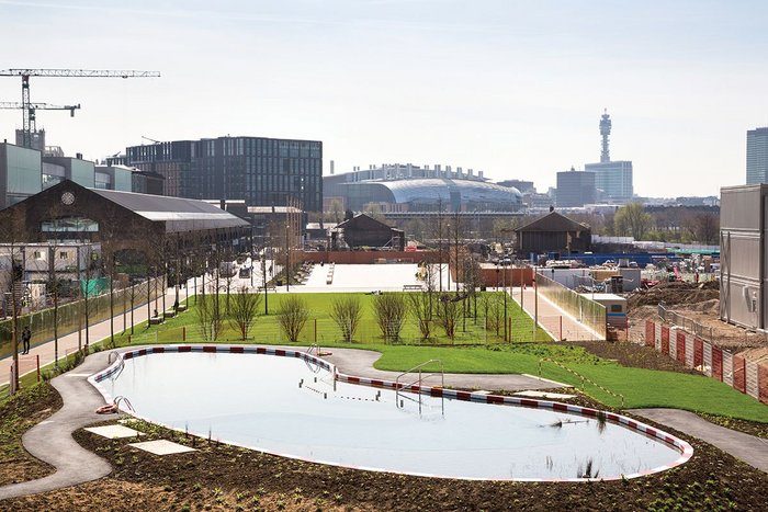 Looking south past Central St Martins to central London.  With lockers, changing cubicles  and kiosk, the natural pond installation is intended to entertain as well as educate.