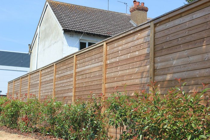 Jacksons' Jakoustic Reflective fencing uses planed timber boards to reflect noise.