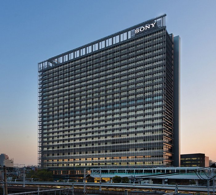 The NBF Osaki building in Tokyo – its east facade a network of fine ceramic pipes with rain  water running through.