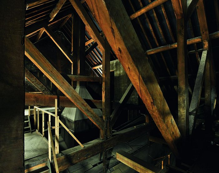 The king post structure of the roof has been retained, but the roof better sealed and insulated, becoming a huge return air plenum.