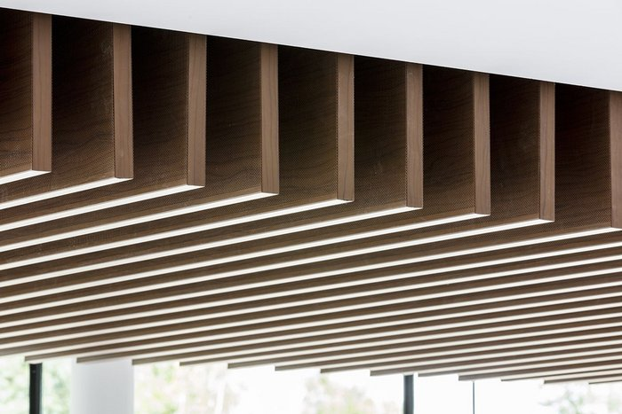 Armstrong has installed wood-effect metal baffles at BPR's refurbishment of Blake House in Uxbridge.
