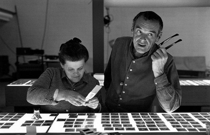 Charles and Ray Eames selecting slides.