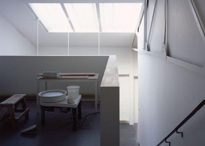 De Waal's pottery space, hidden in the mezzanine above the glazing area.