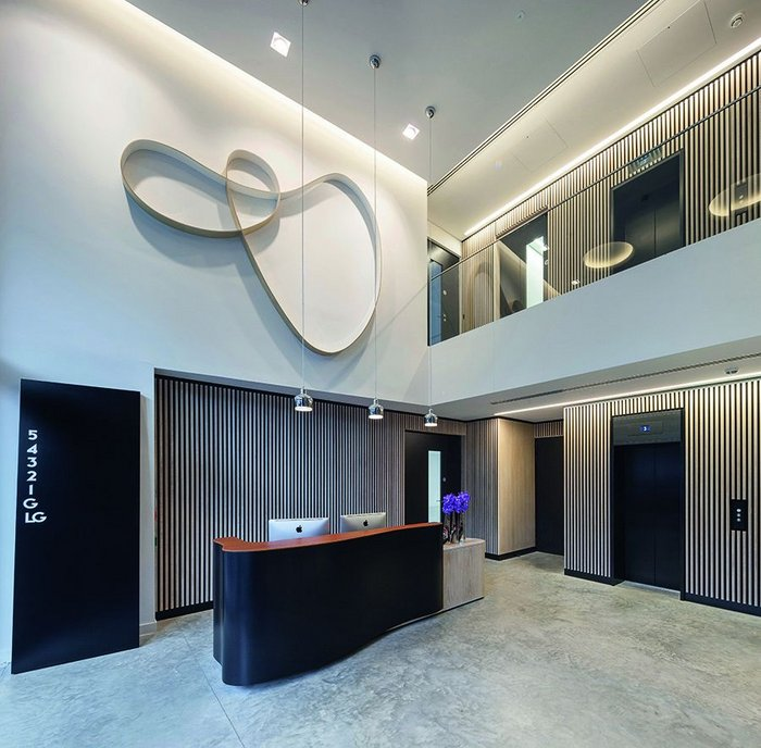 Reception areas complement each other in terms of materials, but remain physically distinct spaces.