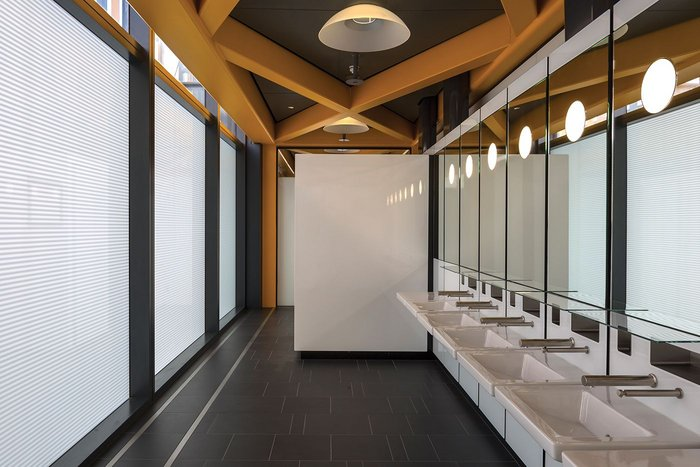 Washrooms in the Leadenhall tower by RSHP: a bringing together of natural light, building structure and bespoke fittings sublimating the washroom to an embodiment of the value of the whole development.