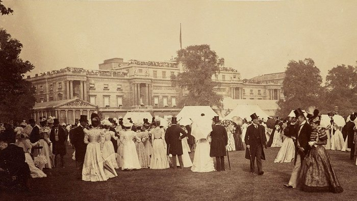 Historically, external shading devices such as awnings prevented direct heat gain from sunlight but allowed daylight in. Here Buckingham Palace is shown with awnings drawn on the day of Queen Victoria's Diamond Jubilee Party in 1897.