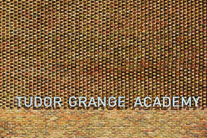 Projecting bricks add texture to the elevation of Tudor Grange Academy.