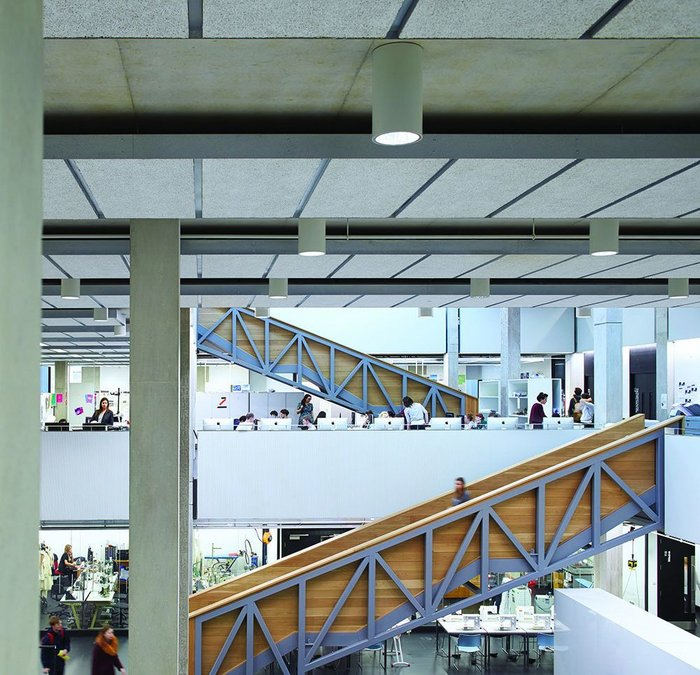 The staircases and walkways show their workings with the structure but encase students in high timber sides – here in the 'factory' space.