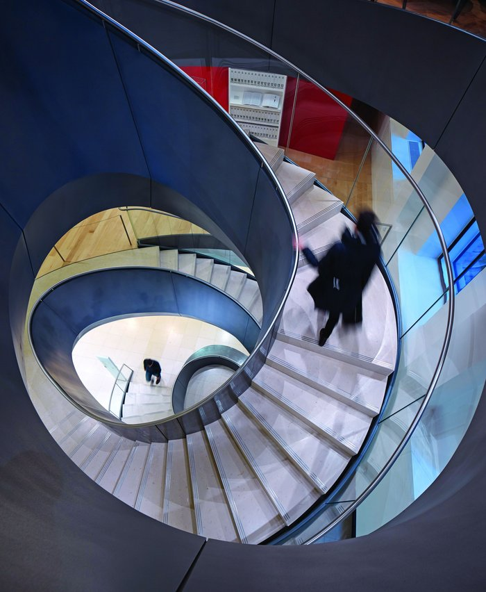 The curious spiral stair geometry feels hand-designed and wrought.