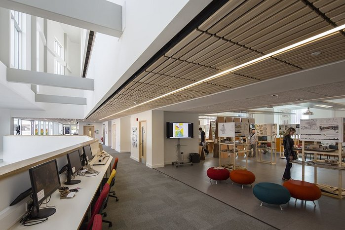 Timber ceilings add a sense of warmth reminscent of school of architecture's previous home