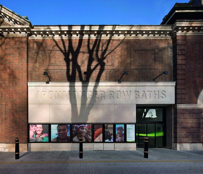 The bold new cast-stone entrance sits at the join between the original building and its late 1930s extension.