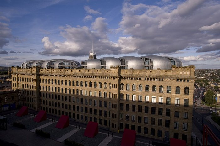 Lister Mills, Bradford by David Morley Architects and Price & Myers. The roof extension uses engineered timber for its light wight.