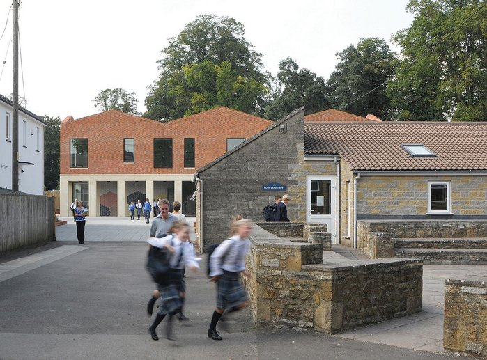 The new teaching block looking west, its formal facade bringing order to the piecemeal buildings behind the main house.