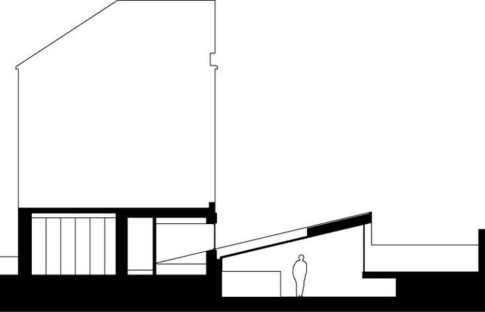 Section through the Cut House, with its angled  kitchen-diner.