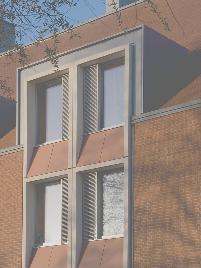 The north-east elevation combines triple-glazing within a super-insulated envelope.