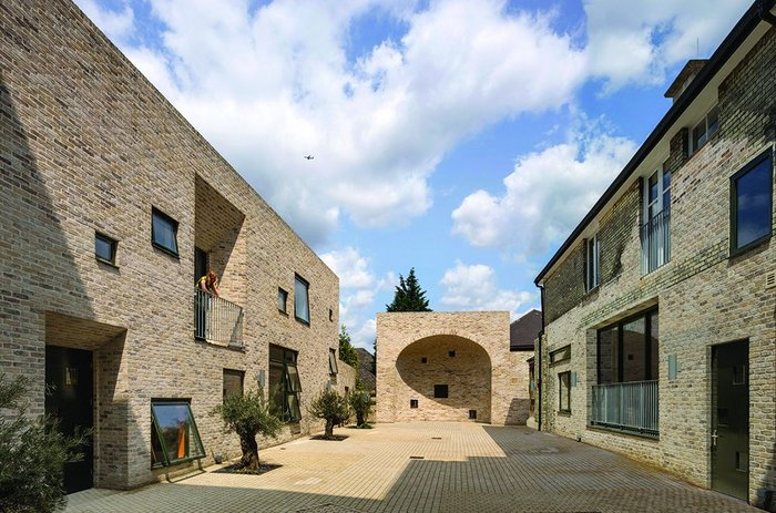 A new courtyard, formed at the rear with a mixture of new and old accommodation, is the heart of the new training and employment advice facility.